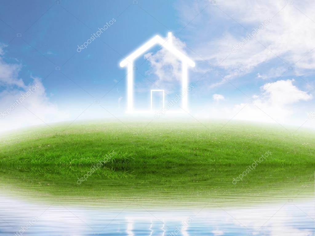 Real estate concept. Eco friendly house on green meadow by the lake