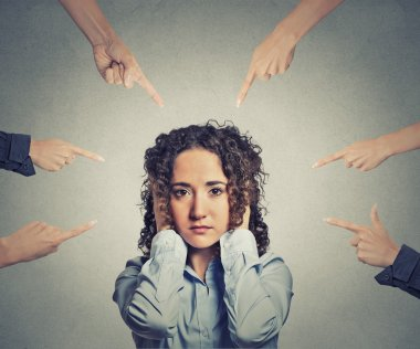 Concept accusation guilty woman many fingers pointing at her