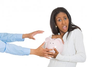 woman holding piggy bank, frustrated trying to protect her savings