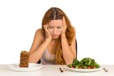 woman tired of diet restrictions craving a cookie