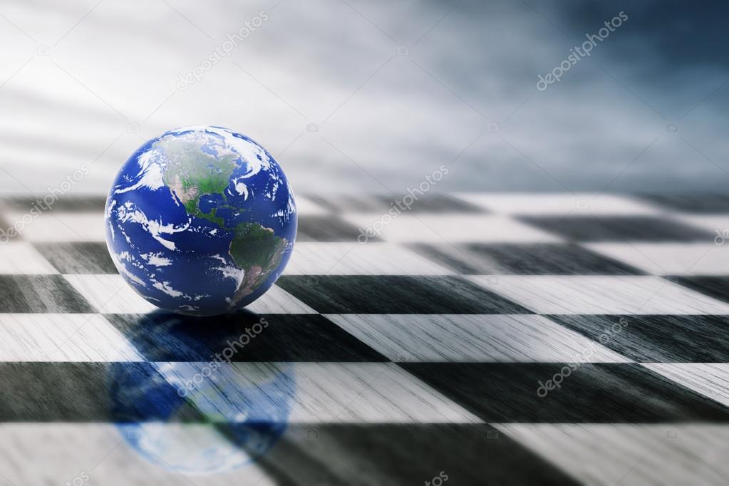 world on a chessboard isolated on blue sky background