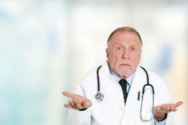 clueless senior health care professional doctor shrug shoulders