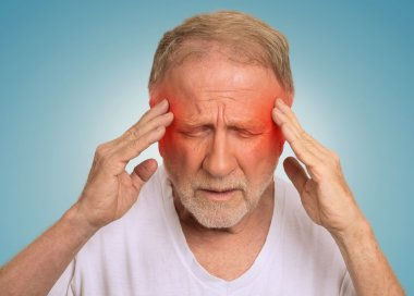 senior man suffering from headache hands on head