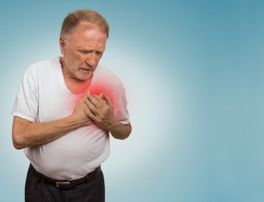 senior man suffering from bad pain in his chest