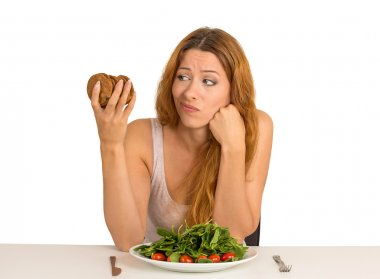 woman tired of diet restrictions craving cookie