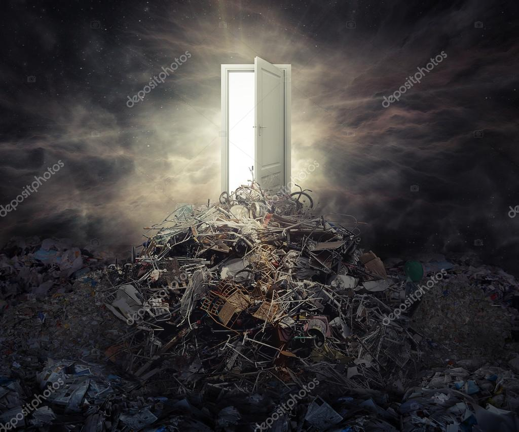 Pollution concept open door on top of mountain of garbage