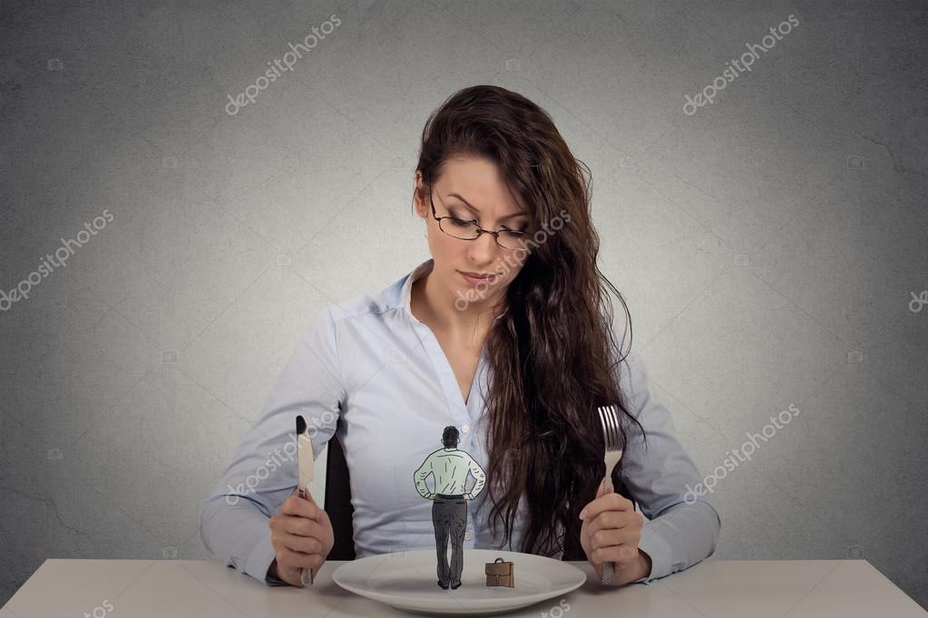 Woman sitting in front of a dish looking at a tiny man