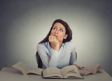 Closeup portrait annoyed, bored, tired, woman, funny student sitting at desk with many books looking up fed up of studying isolated on gray wall background. Face expression, emotion, reaction stock vector