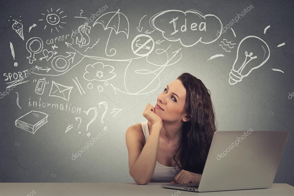 woman with computer thinking dreaming has ideas looking up