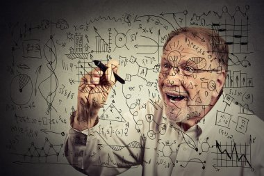 Senior man scientist with glasses writing secret formula with pen