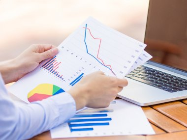 Cropped image hands with financial charts papers