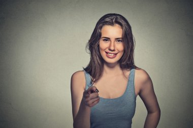 young beautiful casual woman pointing finger at you camera