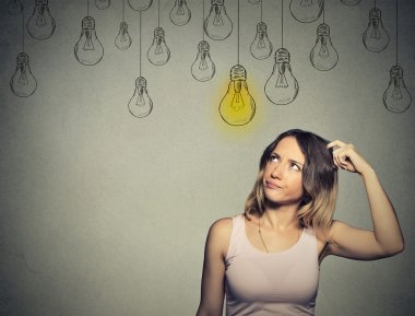 thinking woman looking up with light idea bulb above head