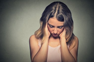 upset sad woman thinking deeply about something