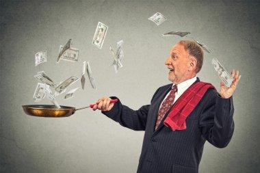 Happy senior elderly business man juggling money dollar bills
