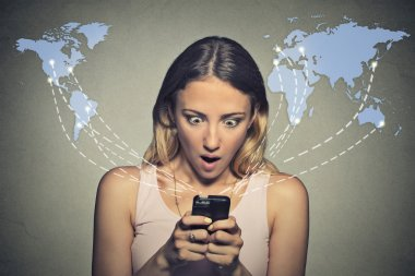 shocked woman looking at her smart phone seeing bad news or photos