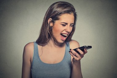 angry young woman screaming on mobile phone