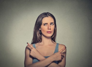 woman pointing in two different directions not sure which way to go in life
