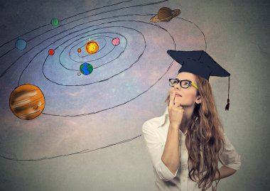 young woman student dreaming, thinking about future, life on other planets