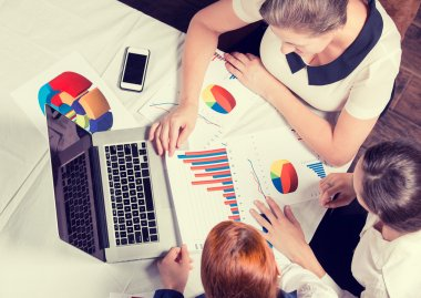 Three business woman investment consultant analyzing company annual financial report