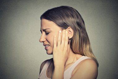 side profile sick young woman having ear pain