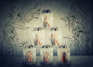 lonely woman sitting in a pile of glass jars surrounded by angry