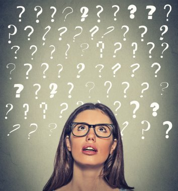 woman with puzzled face expression question marks above her head looking up