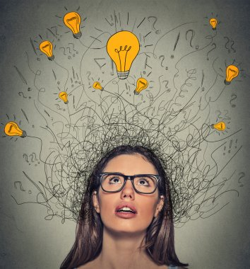 Thinking woman with question signs and light idea bulb above head looking up