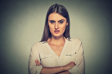 portrait angry displeased woman on gray background