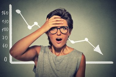 Shocked woman desperate with financial market chart graphic going down
