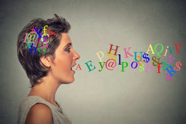 woman talking with alphabet letters in her head coming out of open mouth