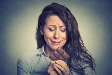 woman tired of diet restrictions craving sweets chocolate