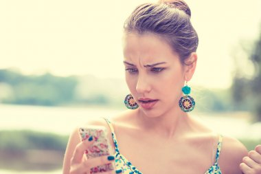 upset sad skeptical unhappy serious woman talking texting on phone