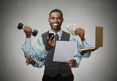 Multitasking happy business man isolated on grey wall background