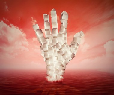 White sugar cubes shaped as human hand floating in blood