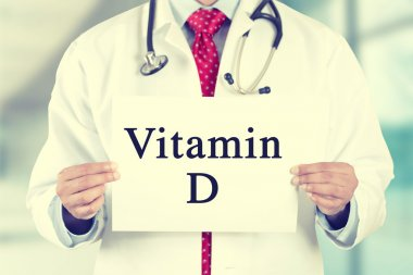 doctor hands holding white card sign with vitamin D text message