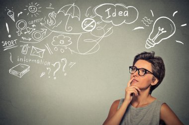 woman thinking dreaming has many ideas looking up