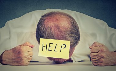 Tired, stressed senior employee needs help