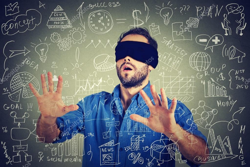 Blindfolded young business man searching walking through social media financial data plan
