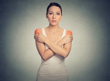 Young woman with bilateral shoulder pain or stiffness colored in