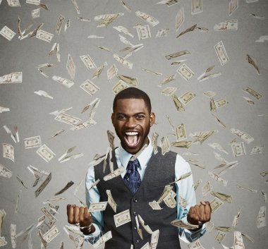 happy man pumping fists ecstatic celebrates success screaming under money rain