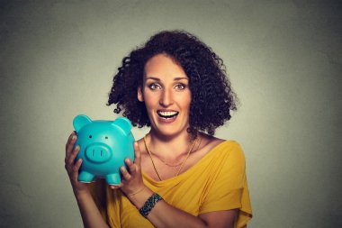 happy, smiling business woman, bank employee holding piggy bank