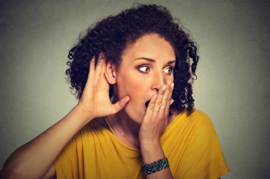 surprised nosy woman hand to ear gesture carefully intently secretly listening