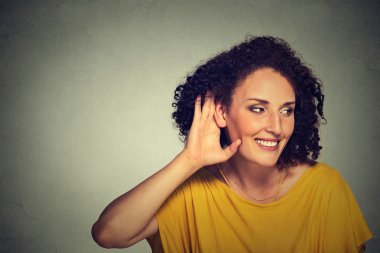 happy middle aged nosy woman hand to ear gesture carefully secretly listening