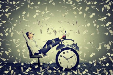 business woman relaxing sitting in her office under money rain