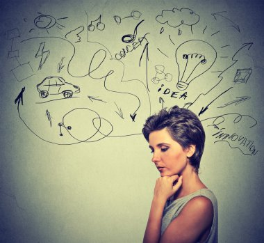 worried young woman thinking dreaming has many ideas looking down