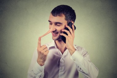 Liar customer service representative. Happy man with long nose talking on mobile phone