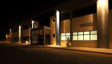 External view of Modern warehouse at night
