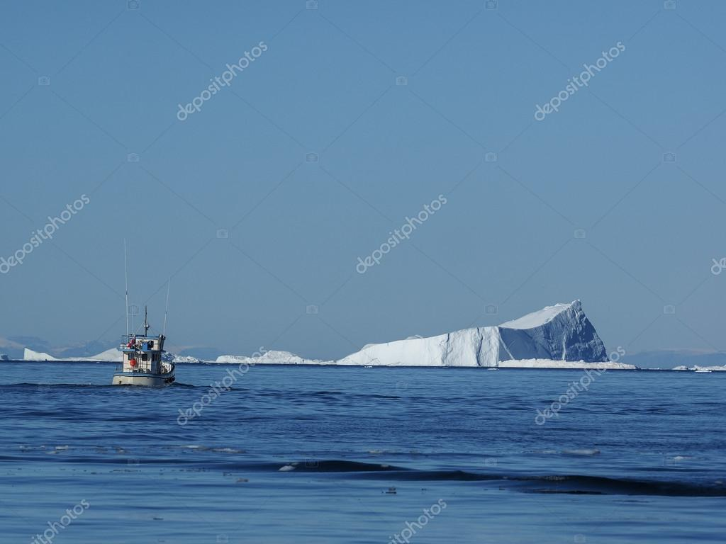 ship in front of Icebergs
