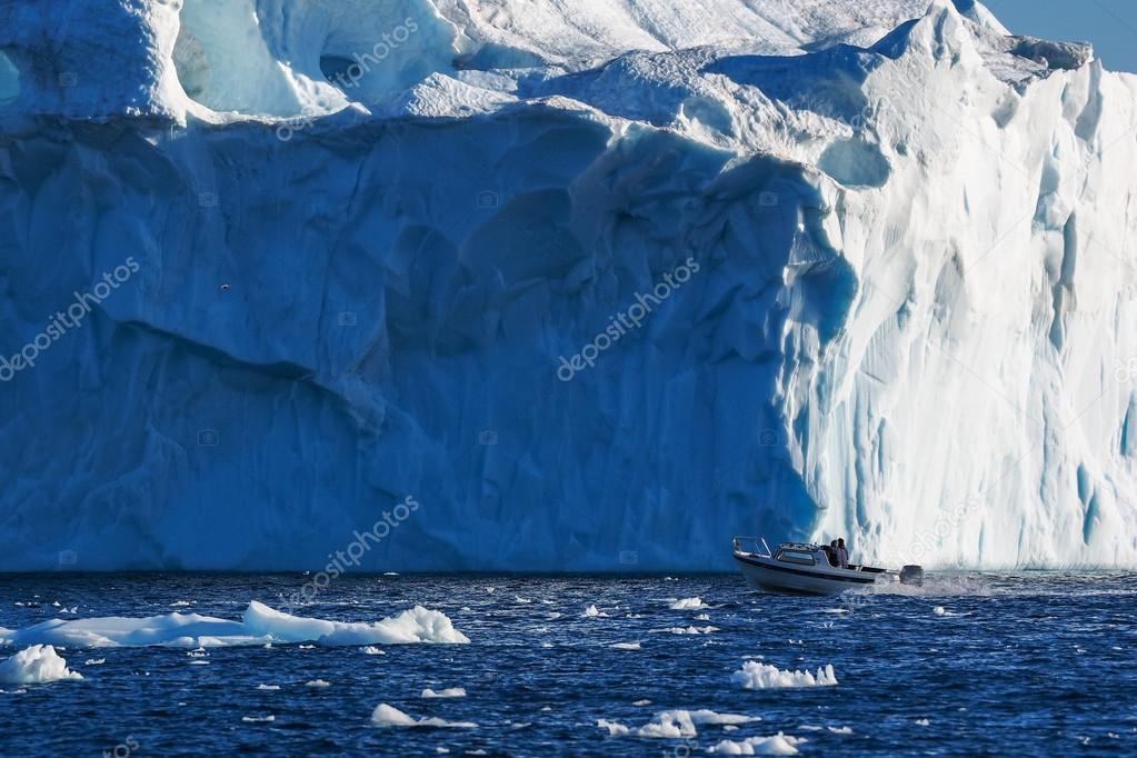 boat in front of Icebergs